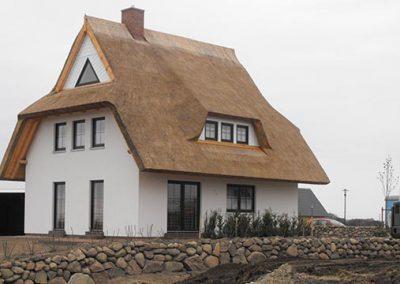 Reetdachhaus mit Schleppgaube